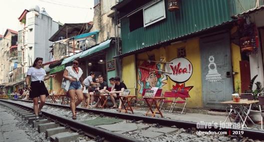 hanoi train street cafe, vietnam military museum, over tourism in vietnam, hanoi train street, where is hanoi train street
